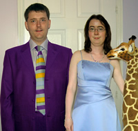 Paul and Edith in their wedding outfits, with a 5ft toy giraffe